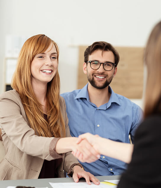 Happy,Young,Couple,Meeting,With,A,Broker,In,Her,Office